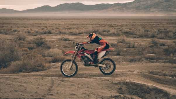 motorcyclist, motorcycling, sand