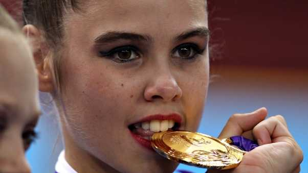 sportswoman, medal, teeth