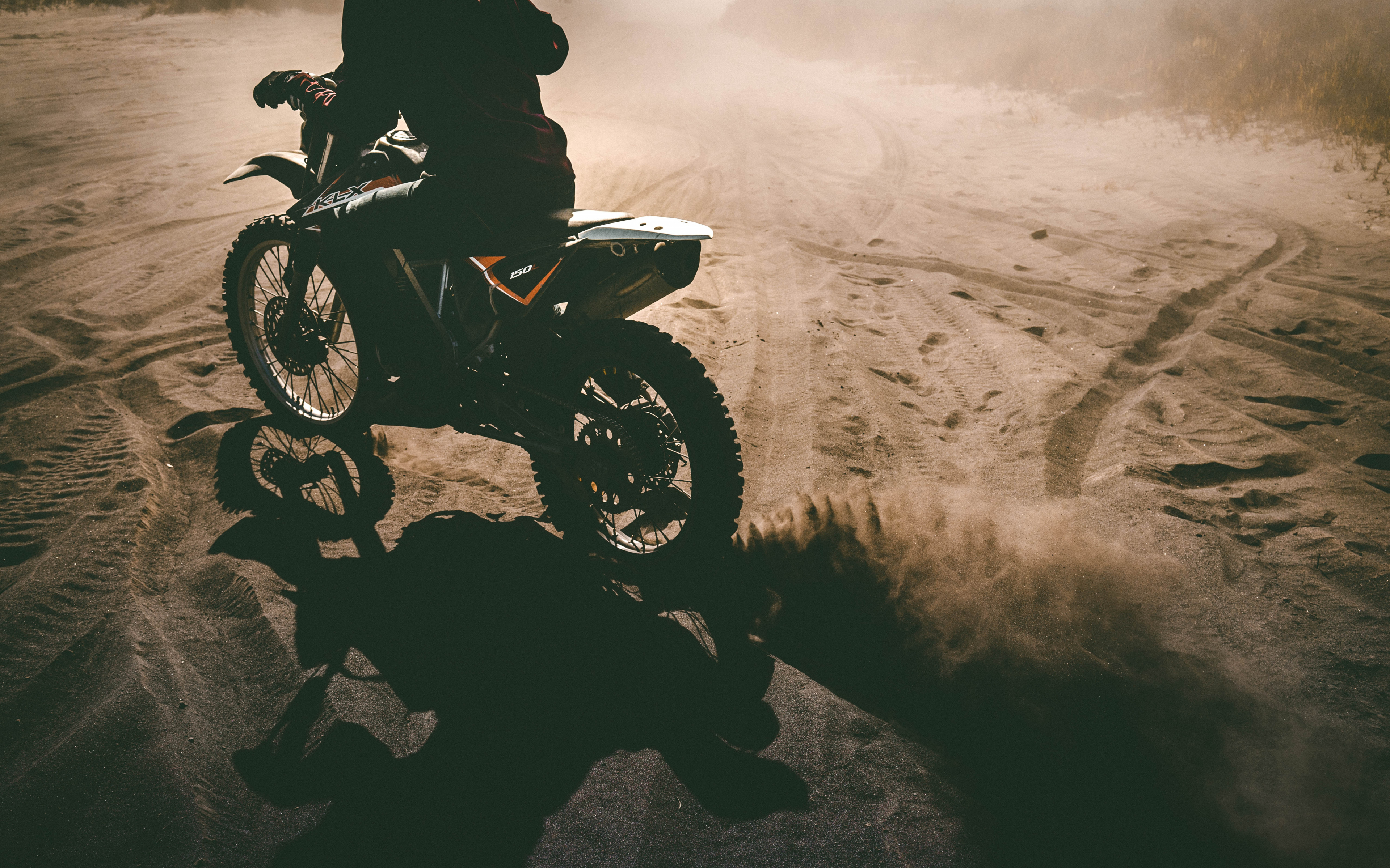 motorcyclist, motorcycle, sand
